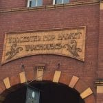 "Photo of the entrance to the hop warehouses. The signage says ""Worcester hop market warehouses"""